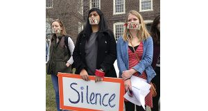 Brown University students Pei Ling Chia, left, and Nicha Ratana, right, gathered with other students on campus in Providence, R.I., this week to protest the school's handling of recent sexual assault cases. (ASSOCIATED PRESS PHOTO)