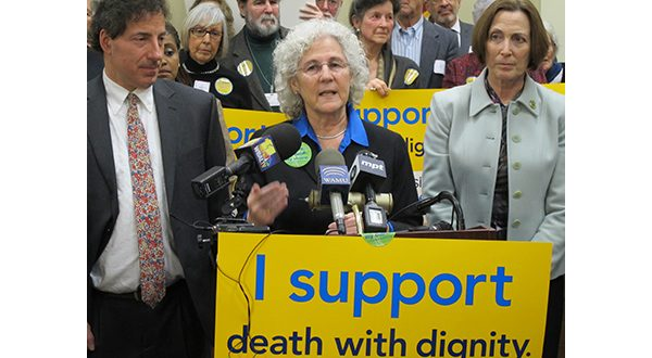 Del. Shane Pendergrass, D-Howard, explains her bill to allow people given no more than six months to live the option of filling a prescription for drugs to hasten their death, during a rally Wednesday, March 4, 2015, in Annapolis, Md. Sen. Jamie Raskin, D-Montgomery, is standing left, and Del. Karen Lewis Young, D-Frederick, is standing right. (AP Photo)