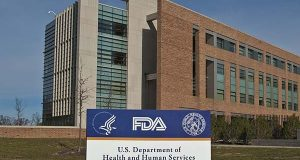 In this 2010 photo by the Food and Drug Administration, FDA Building 21 stands behind the sign at the campus's main entrance on New Hampshire Avenue in Silver Spring. (U.S. FDA photo)