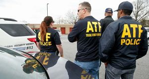 ATF agents gather in a parking lot where media were asked to gather, down the road from the entrance to Ft. Meade after a vehicle rammed a gate to the National Security Agency on Monday.  One person was killed in a firefight that erupted Monday after a car with two people tried to ram a gate at the Fort Meade, Md., military base near a gate to the National Security Agency, according to preliminary reports cited by two U.S. officials.  (AP Photo/Andrew Harnik)