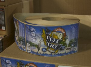 "The label for the Bay IPA features the image found on the Chesapeake Bay Trust's ""Treasure the Chesapeake"" license plates. The license plates, and the organization's outreach, served as an inspiration for the beer, Full Tilt Brewing co-owner Nick Fertig said. (Capital News Service photo by Katelyn Newman)"