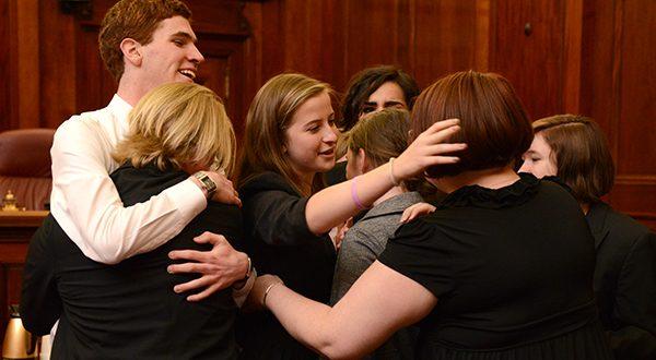 The Severna Park High School mock trial team celebrating their win after Judge Battaglia announced them as the State Championship winners. (The Daily Record/Maximilian Franz)