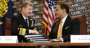 U.S. Naval Academy Superintendent Vice Admiral Ted Carter, left, and UMBC President Freeman Hrabowski will sign a Cooperative Research and Development Agreement to support future partnerships, beginning with five cybersecurity projects. This collaboration has its roots in Admiral Jonathan Greenert's 2014 visit to UMBC, which illuminated the institutions' mutual strengths and interests in cybersecurity. The initial collaborative projects involve areas from tactile authentification for mobile devices to detecting anomalies in cyber-physical systems to securing cloud services using policy-based approaches. (The Daily Record/Maximilian Franz)