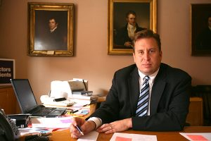 Gene Ransom, III, CEO of MedChi in his Baltimore office in 2010. (The Daily Record/Rich Dennison- FILE)
