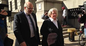 Episcopal Bishop Heather Cook leaves Baltimore City Circuit Court in April 2015 after her arraignment, along with Jose A. Molina, one of her lawyers. Cook pleaded guilty Tuesday to manslaughter, drunken driving and leaving the scene at which she killed a cyclist. (AP Photo/Juliet Linderman)