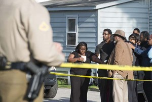 Onlookers gather outside of a house, where say seven children and one adult were found dead Monday, in Princess Anne. Officers were sent to the home Monday after being contacted by a concerned co-worker of the adult. (AP Photo/The Daily Times, Joe Lamberti)