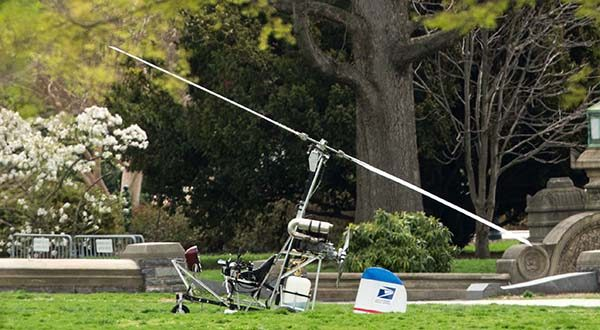 A small helicopter sits on the West Lawn of the Capitol in Washington on Wednesday. U.S. Capitol Police are investigating a gyro copter with a single occupant that has landed on the grassy area of the West Lawn of the U.S. Capitol. (AP Photo/Andrew Harnik)