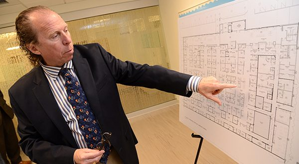 Dr. Ken Williams, president of the Seton Medical Group, shows a floor plan of the soon-to-open Saint Agnes Medical Group's patient-centered medical facility. (The Daily Record/Maximilian Franz)