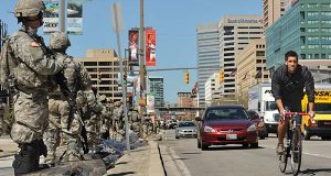 National Guardsmen patrol Baltimore, Tuesday, April 28, 2015. Baltimore was a city on edge Tuesday as hundreds of National Guardsmen patrolled the streets against unrest for the first time since 1968, hoping to prevent another outbreak of rioting. (Amy Davis/The Baltimore Sun via AP)
