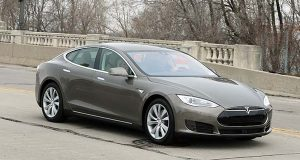 In this Tuesday, April 7, 2015 photo, a Tesla Model S 70-D electric car is test driven in Detroit. Tesla is going after mainstream luxury car buyers by boosting the range, power and price of its low-end Model S. (AP Photo/Carlos Osorio)
