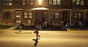 Children play at a party at the public housing complex where Freddie Gray was arrested as a six-day curfew was lifted Sunday in Baltimore. (AP Photo/Patrick Semansky)