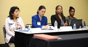 From left, Sulma Guzman, Casa de Maryland; Anita Earls, Southern Coalition for Social Justice; Camille Homes, National Legal Aid and Defender Association; Camilla Roberson, Public Justice Center; speaking during the Forum: Implicit Bias, Structural Racism & Implications for Legal Services Advocacy, at the Maryland Partners for Justice Conference at the Baltimore Convention Center. (The Daily Record/Maximilian Franz)