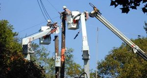 BGE workers work on some power lines in 2001. (File)