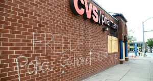 The CVS Pharmacy at the intersection of Pennsylvania and North Avenue is still boarded up following looting late last month. CVS says it plans to renovate and reopen the store.  (The Daily Record / Maximilian Franz)