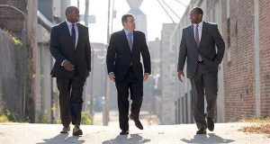 From left, Eugene Monroe of 4th Down Partners, Arsh Mirmiran, of Caves Valley Partners, and 4th Down's Keith Payne, Jr. walking down Creek Alley in the Leadenhall community of South Baltimore where they plan to develop the Stadium Square mixed use community. (File photo)