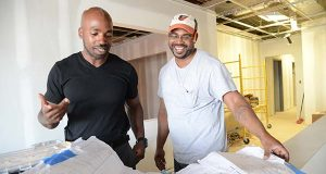 From left, Christopher Wilson, owner of Barclay Investment Corporation, seen here with Terrence Knox, owner of Knox Construction, LLC., at one of Terrence's construction sites at Edmondson Village Shopping Center in Northwest Baltimore. Christopher is an ex-convict turned entrepreneur who started his business to help other people with similar pasts get jobs through his affordable construction, cleaning and consulting service. Terrence is one of Christopher's former employees who he helped start his own business. (The Daily Record/Maximilian Franz).