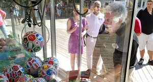 Gov. Hogan plays a claw machine in ocean city last August while on the campaign trail. (File)