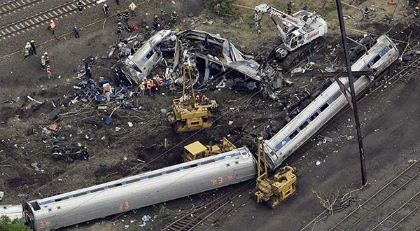 Emergency personnel work at the scene of a deadly train derailment May 13, 2015 in Philadelphia. (AP Photo/Patrick Semansky)