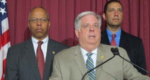 Maryland Gov. Larry Hogan announces an end to a state of emergency in Baltimore during a news conference Wednesday in Baltimore. Hogan issued the state of emergency last week in response to rioting that happened April 27 after the death of Freddie Gray. Lt. Gov. Boyd Rutherford is standing to the left, and Keiffer Mitchell, who will be a liaison for the governor's office to Baltimore, is standing to the right.  (AP Photo/Brian Witte)