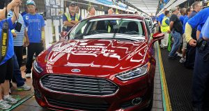 This Aug. 29, 2013 photo shows a new 2014 Ford Fusion at the Flat Rock Assembly Plant in Flat Rock, Mich.(Charles V. Tines/Detroit News via AP, File)