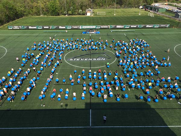 Nearly 400 participants contributed to breaking the world record exercise ball class at Stevenson University's Owings Mills Campus on Wednesday. The previous record was 354 people. (The Daily Record/ Maximilian Franz)