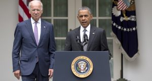 President Barack Obama, joined by Vice President Joe Biden, arrives to speak in the Rose Garden of the White House, Thursday. (AP Photo/Carolyn Kaster)