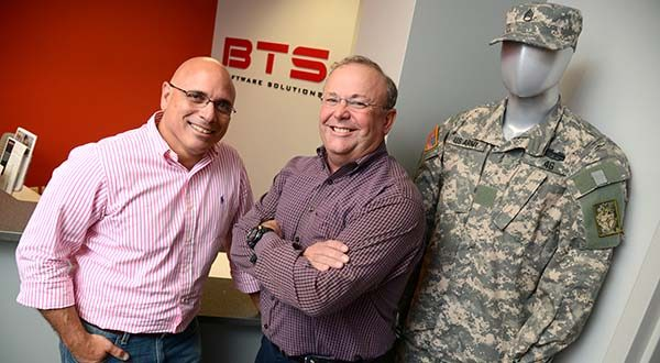 From Left, David Tohn, CEO and Dan Cummings, COO of BTS Software Solutions, standing in the lobby of their office in Columbia. (The Daily Record/Maximilian Franz)