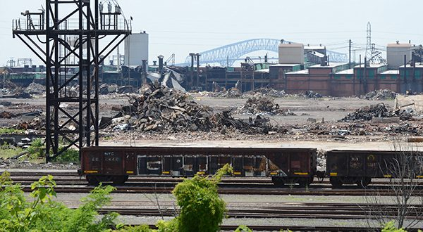 An overview of the demolition site at Sparrows Point with the Key Bridge seen in the background. (The Daily Record/Maximilian Franz)