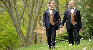 From left, Brandon and Sean Carter-Cooper walking together on their wedding day, April 21st, 2012. Photo by Maximilian Franz.