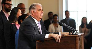 "Maryland Gov. Larry Hogan speaks during a news conference about his cancer diagnoses in Annapolis on Monday. Hogan has ""very advanced"" and ""very aggressive"" cancer of the lymph nodes, but he said Monday he will continue to work as the state's chief elected official. (Algerina Perna/The Baltimore Sun via AP)"