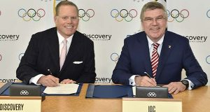 In this image released by the IOC, Discovery Communications President and CEO David Zaslav, left, and IOC President Thomas Bach sign an agreement in Lausanne, Switzerland on Monday.  U.S.-based media giant Discovery Communications Inc. secured the European broadcast rights for four Olympics through 2024 on Monday in a landmark deal worth 1.3 billion euros ($1.45 billion). (Christphe Moratal/IOC via AP)