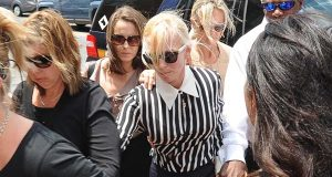 Molly Shattuck, center, a former Baltimore Ravens cheerleader and the ex-wife of a prominent Maryland energy executive, arrives at Sussex County Courthouse on June 16 in Georgetown, Del., where she pleaded guilty to one count of fourth-degree rape, a felony that can carry up to 15 years in jail. (Jason Minto/The Wilmington News-Journal via AP)
