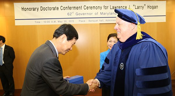 Maryland Gov. Hogan receives an honorary doctorate at Han Yang University in Seoul, South Korea. Hogan was in Seoul on an economic development trip and made a point of stating that he was staying at Marriott hotels.  Before the trip, Hogan vetoed a bill that would have clarified how the state's online hotel tax applies to online booking companies, a bill that Marriott International wanted the governor to sign during a time when the Bethesda-based company is searching for a new headquarters. (Photo by MDGovpics)
