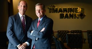 Jack E. Steil, left, the chairman and chief executive officer of 1st Mariner Bank, and  Robert D. Kunisch, Jr, its president and chief operating officer, sit in the boardroom at the bank's headquarters at Canton Crossing in Canton. (The Daily Record/Maximilian Franz)