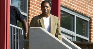 Former U.S. Rep. Jesse Jackson Jr. speaks to the media as he leaves a halfway house in June in Baltimore, where he'd been living since his release from an Alabama federal prison in March. He was convicted in 2013 for misuse of campaign funds. (AP Photo/Jose Luis Magana)