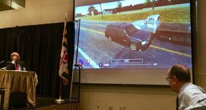 James O'Conor Gentry, an attorney with Salsbury, Clements, Bekman, Marder & Adkins LLC in Baltimore, right, shows a simulation of a car crash on Friday during the Maryland State Bar Association annual meeting in Ocean City. (The Daily Record / Lauren Kirkwood)