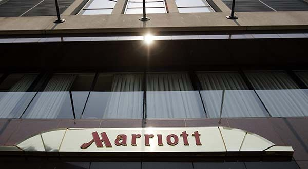This July 9, 2008, file photo shows the exterior of the Marriott Hotel in San Francisco. Marriott International Inc. said Wednesday its flagship hotel unit will offer guests access to Netflix Inc.'s streaming-video service on TVs in its guest rooms. (AP Photo/Paul Sakuma, File)
