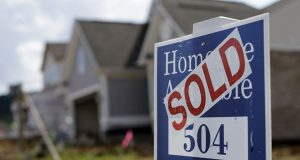 A sold sign sits in front of a new home development under construction in Nashville, Tenn.  (AP Photo/Mark Humphrey)