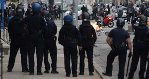 Police officers work as a riot was underway April 27 in Baltimore (The Daily Record / Maximilian Franz)