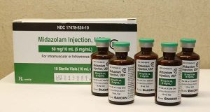 FILE - This July 25, 2014 file photo shows bottles of midazolam at a hospital pharmacy in Oklahoma City. On Monday, the Supreme Court voted 5-4 in a case from Oklahoma saying that the sedative midazolam can be used in executions without violating the Eighth Amendment prohibition on cruel and unusual punishment. (AP Photo/Sue Ogrocki, File)