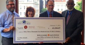 Attorneys Jane Santoni and Robert W. Murphy, center, present Maryland Legal Aid with a $63,000 check that is a cy pres award from a class-action lawsuit they settled earlier this year. Representing Legal Aid are Chief Counsel C. Shawn Boehringer, far left, and Executive Director Wilhelm H. Joseph Jr., far right. (Photo courtesy of Maryland Legal Aid)