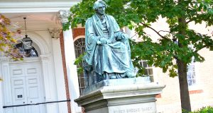 This statue of U.S. Supreme Court Chief Justice Roger Brooke Taney sits on the front lawn of the Maryland State House. Some delegates have called for its removal citing Taney's role in the Dred Scott decision. (The Daily Record/Bryan P. Sears)