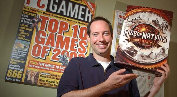 In this 2004 photo, Tim Train, who is now CEO of Big Huge Games, holds an oversized box for the Rise of Nations computer game.