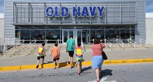 A mother with children walking into the old Navy store in Timonium in 2011. The National Retail Federation predicted a drop in the next month's back-to-school spending, which could be a harbinger of things to come for retailers this holiday season. (The Daily Record/Maximilian Franz).