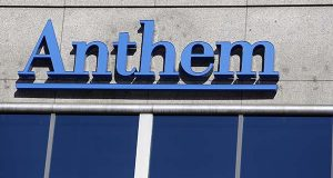 FILE - This Feb. 5, 2015 file photo shows the Anthem logo at the health insurer's corporate headquarters in Indianapolis. Anthem is buying rival Cigna, in a deal valued at $54.2 billion announced Friday, July 24, 2015, that will create the nation's largest health insurer by enrollment, covering about 53 million patients in the U.S.  (AP Photo/Michael Conroy, File)