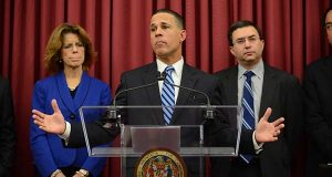 In this 2013 photo, former Lt. Gov. Anthony G. Brown, center, speaks about Maryland's troubled health exchange, as he was flanked by Carolyn Quattrocki, left, who is now executive director of the exchange, and Dr. Joshua Sharfstein, right, who was secretary of the state Department of Health and Mental Hygiene. (The Daily Record file)