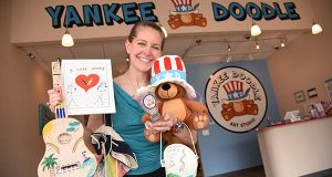 The Yankee Doodle Art Studio in Cockeysville, MD, owned by Judith Salzman Tortera, an attorney at Weinstock, Freidman & Freidman who is seen here in the lobby holding a variety of art projects that can be created in the store. (The Daily Record/Maximilian Franz)