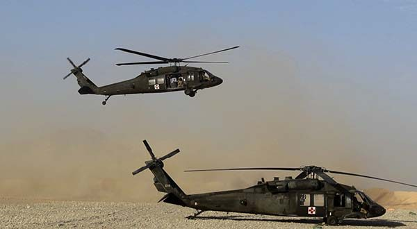 "In this Sunday, Sept. 4, 2011, file photo, a Black Hawk helicopter of the U.S. Army's Task Force Lift ""Dust Off,"" Charlie Company 1-71 Aviation Regiment, returns from a mission at Forward Operating Base Edi in the Helmand Province of southern Afghanistan. Lockheed Martin Corp. said Monday, July 20, 2015, that it is buying Black Hawk helicopter maker Sikorsky Aircraft for $9 billion. (AP Photo/Rafiq Maqbool, File)"