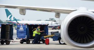 A luggage cart drives by a Southwest plane at terminal in BWI Airport. (File)