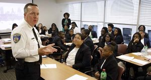 Interim Baltimore Police Commissioner Kevin Davis, left, speaks with students participating in a junior state's attorney program on Thursday in Baltimore. Davis replaced Commissioner Anthony Batts, who was fired Wednesday by Mayor Stephanie Rawlings-Blake amid the worst crime spike in the city since the 1970s. (AP Photo/Patrick Semansky)